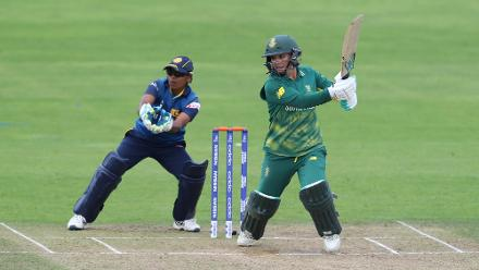 Dilani Manodara of Sri Lanka looks on as Mignon Du Preez of South Africa hits out during The ICC Women's World Cup 2017 match.