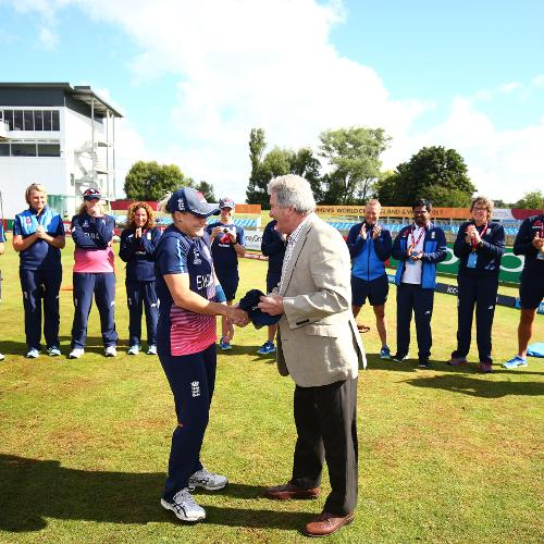 Katherine Brunt is presented with her 100th ODI cap by her father.