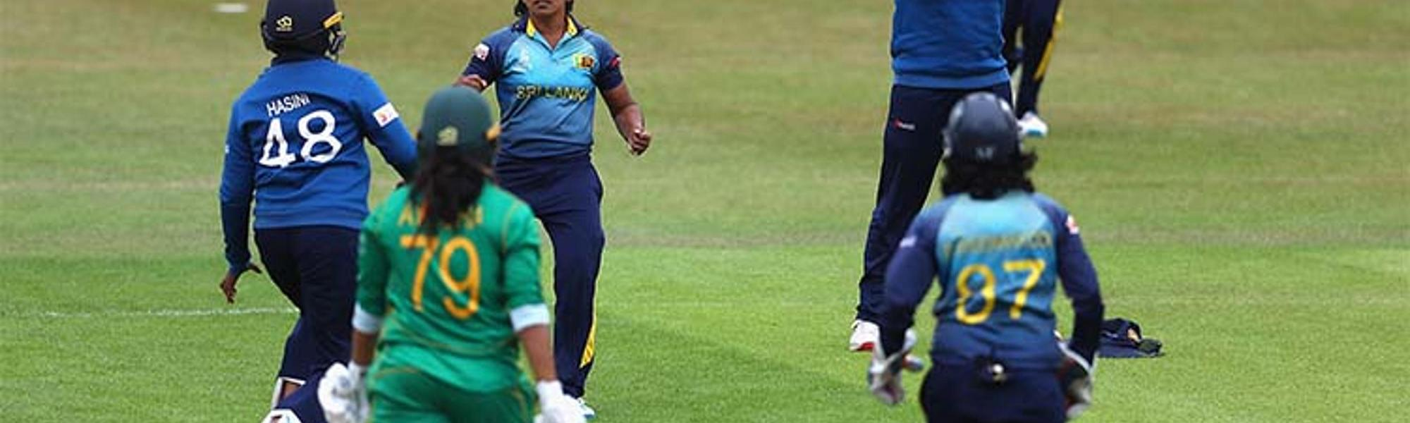 Sri Lanka celebrate their first win.
