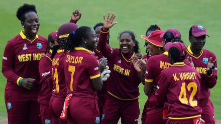 Afy Fletcher of West Indies(C) celebrates after dismissing Fran Wilson of England.