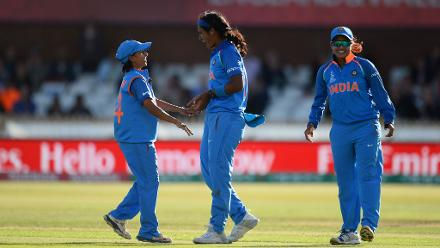 Shikha Pandey celebrates the wicket of Ellyse Perry.