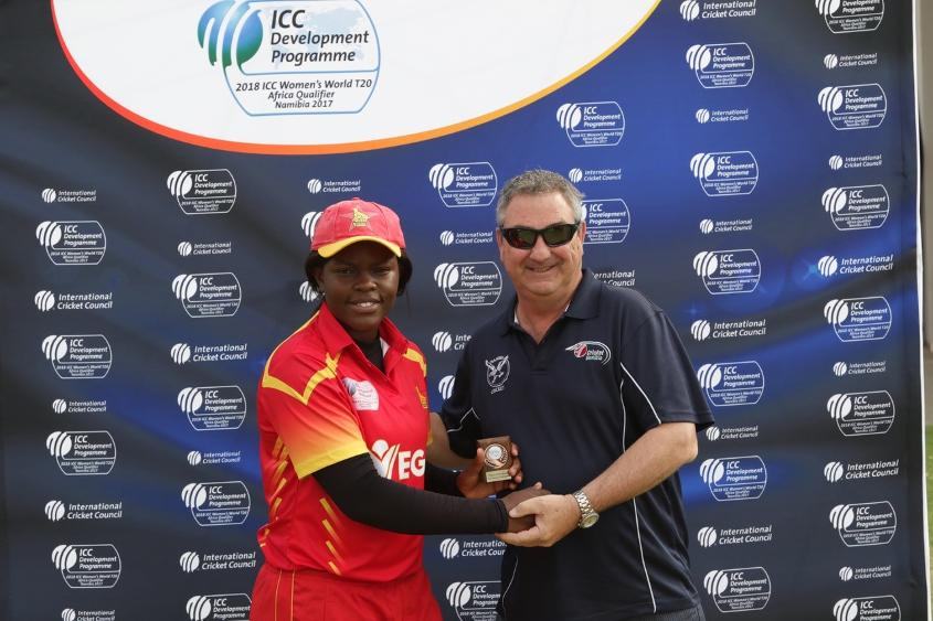 Chipo Mugeri receives player of match award from Richard Frankle