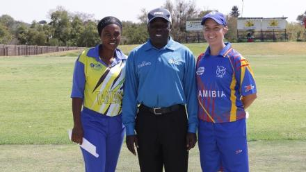Fatuma Kibasu and Petro Enright at the toss with umpire Francis Ekalungar