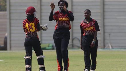 Uganda celebrate the wicket of Getrude Chanidru