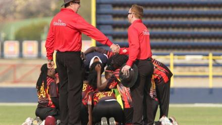 Umpires Jeff Luck and Andrew Louw congratulates Uganda