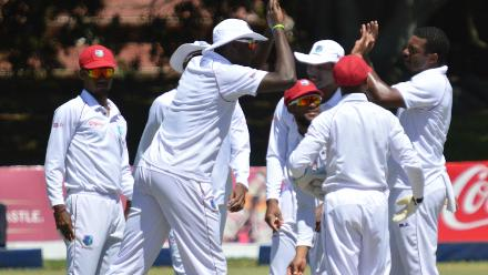 Windies players celebrate after restricting Zimbabwe for 326 in the first innings.