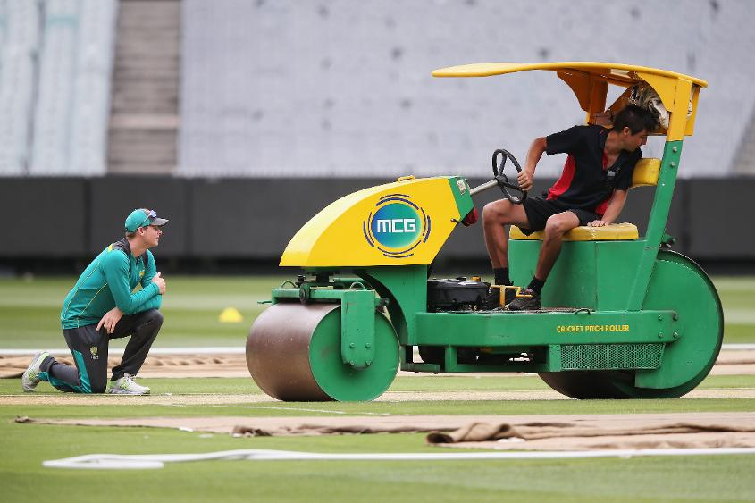 Smith looks on at the MCG pitch being prepared.jpg