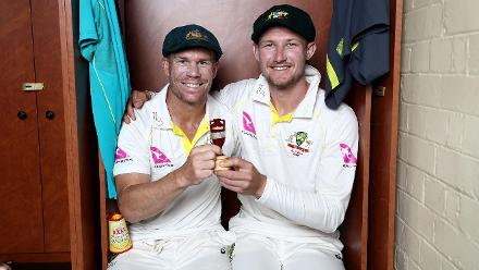 The Australian openers - David Warner and Cameron Bancroft - pose with the Ashes urn.