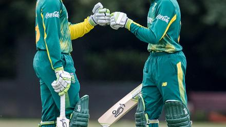 South Africa's Jiveshan Pillay (L) and Hermann Rolfes meet mid-pitch