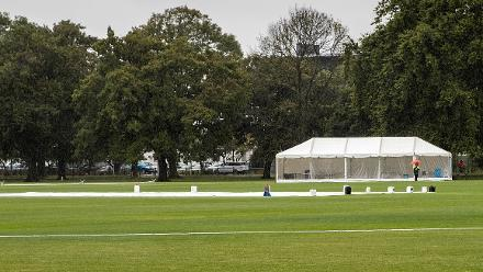 A lone security guard patrols as wet weather causes all matches to be abandoned without a ball bowled at the ICC U19 Cricket World Cup Warm Ups