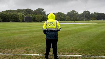 A security guard patrols as wet weather causes all matches to be abandoned without a ball bowled at the ICC U19 Cricket World Cup Warm Ups