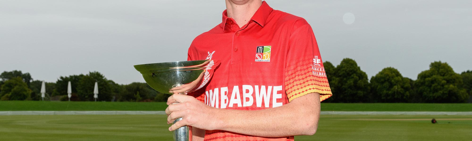 Zimbabwe U19 captain Liam Roche poses with the ICC Under 19 Cricket World Cup trophy.