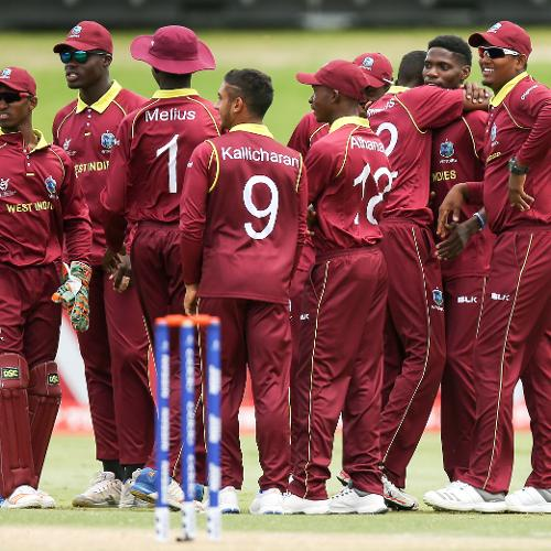 West Indies players celebrate after taking the wicket of Matthew Breetzke