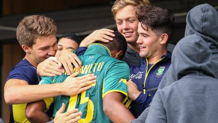 Wandile Makwetu of South Africa is congratulated by teammates after hitting 99 not out