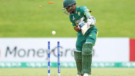 Kenan Smith of South Africa is bowled out