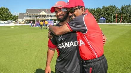 Captain Arslan Khan (L) of Canada is congratulated after the game