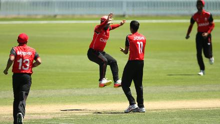 Arslan Khan (C) of Canada celebrates with team mate Rishiv Joshi after taking a catch