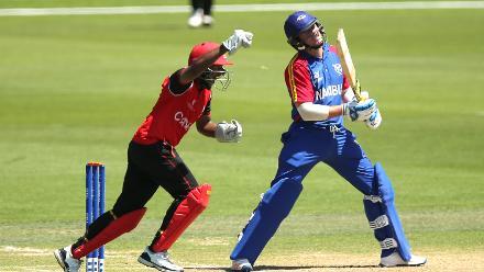 Krishen Samuel of Canada celebrates the wicket of Eben van Wyk