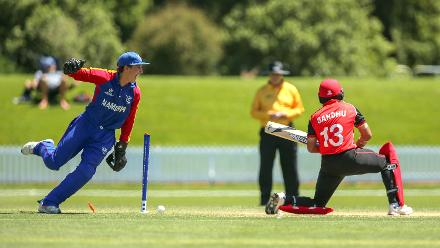 Lohan Louwrens of Namibia celebrates the wicket of Randhir Sandhu