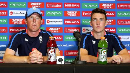 Euan Wood (L) and Harry Brook of England speak to the media