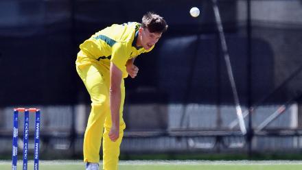 Ryan Hadley of Australia bowling