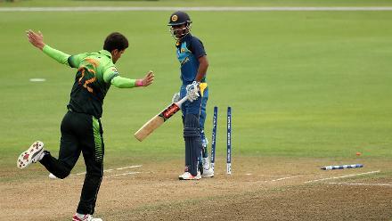 Bowler Shaheen Shan (L) of Pakistan celebrates taking the wicket of Krishan Sanjula of Sri Lanka (R)