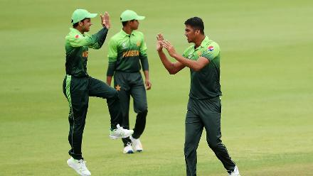 Arshad Iqbal of Pakistan (R) takes a wicket