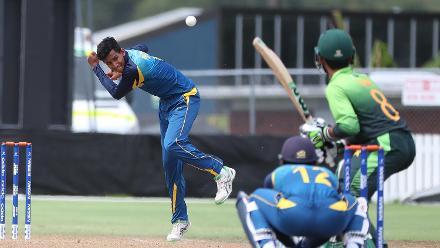 Praveen Jayawickrama of Sri Lanka bowls
