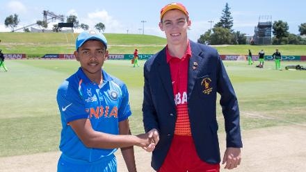 Captain Prithvi Shaw of India (L) and Captain Liam Roche of Zimbabwe shake hands