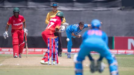 Kamlesh Nagarkoti of India bowls to Wesley Madhavere of Zimbabwe