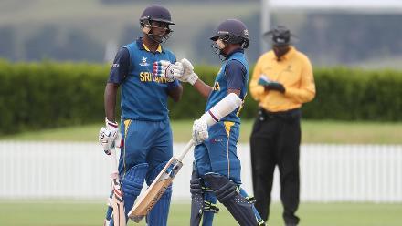 Sri Lankan batsman Jehan Daniel (L) and Ashen Bandara (R) celebrating