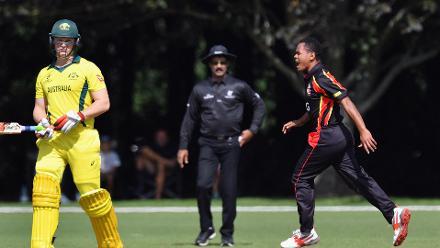 Sema Kamea of Papua New Guinea (R) celebrates after dismissing Max Bryant