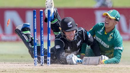 Finn Allen of New Zealand is run out for 27 by Jade de Klerk