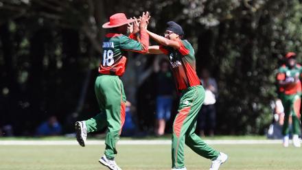 Jasraj Kundi of (R) is congratulated by Ankit Hirani