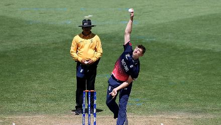 Luke Hollman of England bowling