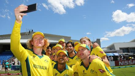 Australian players pose for a selfie after winning