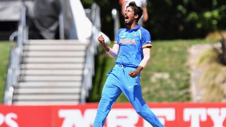 Ishan Porel of India celebrates after dismissing Ali Zaryab