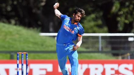 Ishan Porel of India bowls