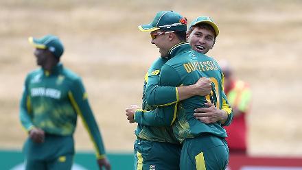 Raynard van Tonder and Jean du Plessis celebrate a wicket