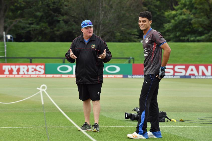 Andy Moles with Naveen Ul Haq