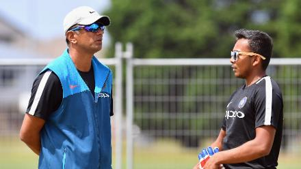 Head Coach Rahul Dravid and captain Prithvi Shaw of India during training
