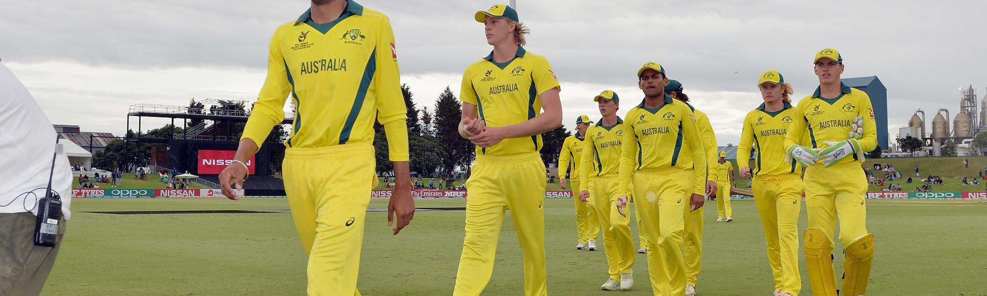 Jason Sangha and Australia's players leave the field
