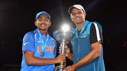 Captain and coach with trophy