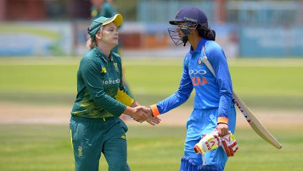 Mandhana is congratulated by South Africa captain Dane van Niekerk following her innings of 135 at the Diamond Oval in Kimberley
