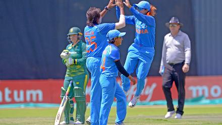 Jhulan Goswami celebrates with team-mates after claiming her 200th ODI wicket during the second ODI against South Africa at the Diamond Oval in Kimberley on Wednesday