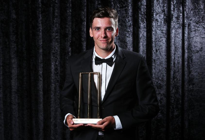 Jhye Richardson poses with the Bradman Young Cricketer of the Year award
