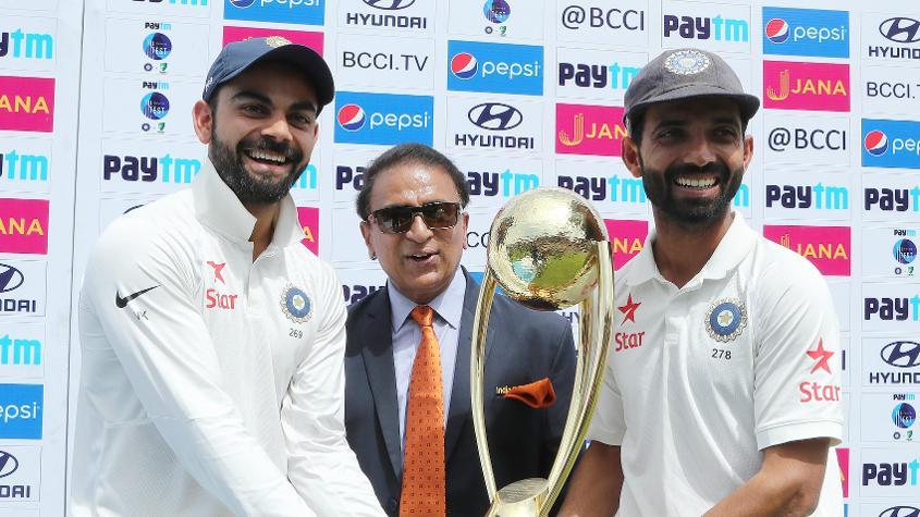 Virat Kohli and Ajinkya Rahane received the Border-Gavaskar Trophy from Sunil Gavaskar after the 2-1 series win
