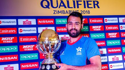 Hong Kong captain Babar Hayat holds the ICC World World Cup Qualifier Trophyat Harare Sports Club ahead of the Qualifiers in Zimbabwe, 26 February 2018