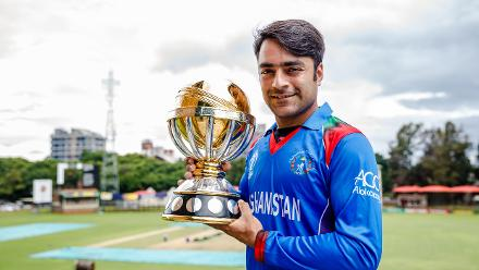 Afghanistan vice captain Rashid Khan holds the ICC World Cup Qualifier Trophy at Harare Sports Club ahead of the Qualifiers in Zimbabwe, 26 February 2018