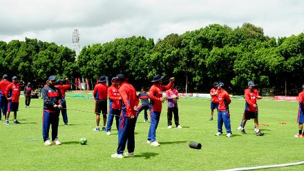 Nepal Cricket Team goes through their stretching routine at Queens Sports Club ahead of their clash with host nation Zimbabwe